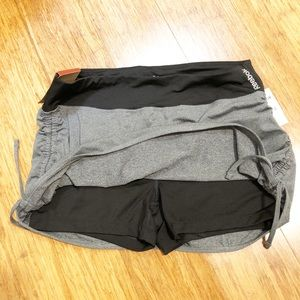 NWT Reebok gray/black athletic skort. Medium.
